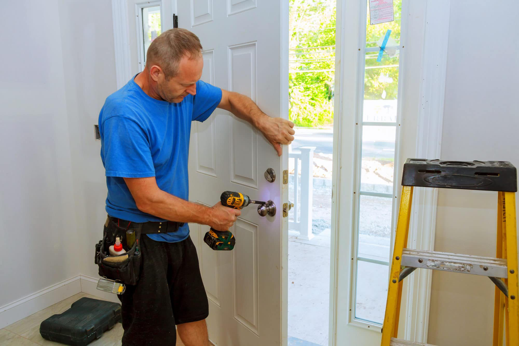Carpenter installs new door and new door hardware to keep the Arizona heat out and lower the utility bills