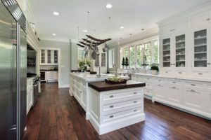 "Can you say ""cabinets""! White beautiful cabinets everywhere define this gorgeous galley kitchen."