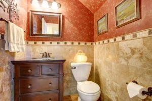 Who says small has to be simple? This small powder room with vaulted ceilings includes a beautiful marble tile wall.