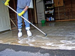 Acid cleaning and resealing this garage floor will keeps oil spills and water out. Water that seeps into the concrete and freezes will crack your cement.