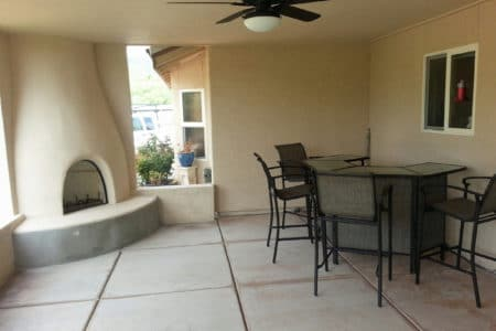 Sierra Remodeling adobe style outdoor patio with kiva fireplace