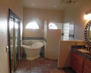 Sierra Remodeling master bathroom remodel with curved alcove bathtub