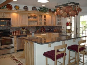 Sierra Remodeling kitchen remodel light oak cabinets, large island, granite counters and stainless steel appliances