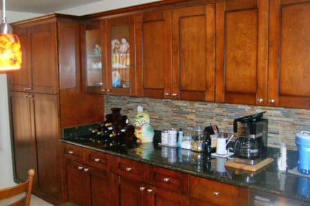 Sierra Remodeling kitchen remodel cherry shaker cabinets with multi color backsplash and granite countertops