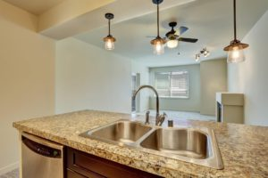 Sierra Remodeling installs beautiful double sinks and granite countertops.