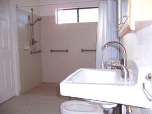 Sierra Remodeling - ADA compliant bathroom with roll-under sink, bidet and wheelchair roll-in shower