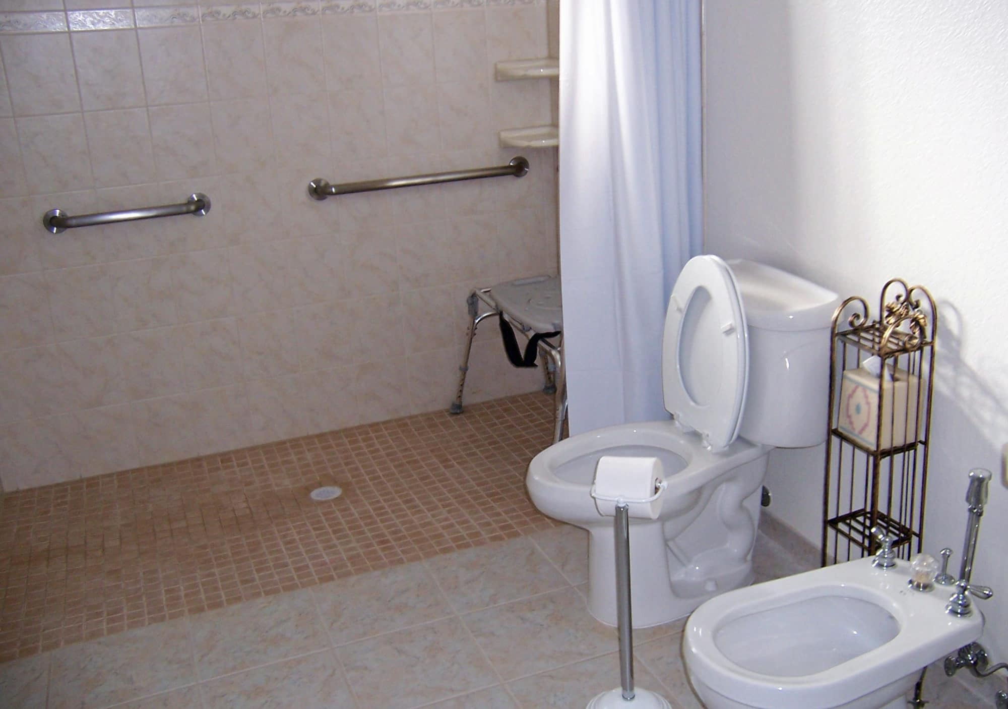Sierra Remodeling designs and builds ADA compliant bathrooms with roll-in shower, grab bars, ADA compliant commode, bidet and sink