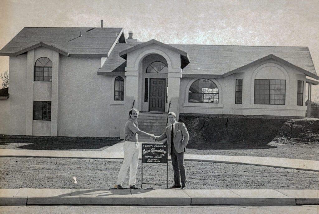 SR&HB CEO Howard Richter (left) and realtor place SR&HB custom home on the market!