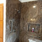 Sierra Remodeling ADA Compliant Tahoe granite shower with large niche, bench seat and grab bars