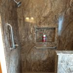 Sierra Remodeling ada compliant Tahoe granite shower with bench seating, grab bars and handy niche
